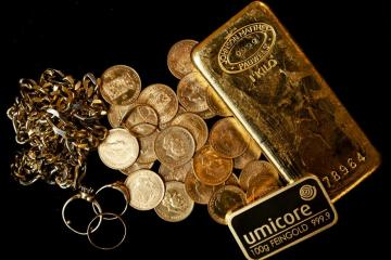 Gold dips on robust dollar, higher yields ahead of key central bank meetings