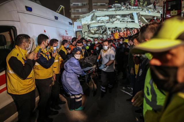Rescuers free three women trapped in earthquake rubble for 10 hours