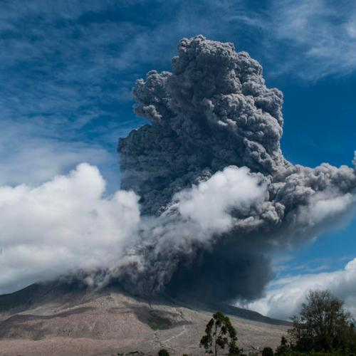 Indonesian volcano erupts, forcing residents to flee