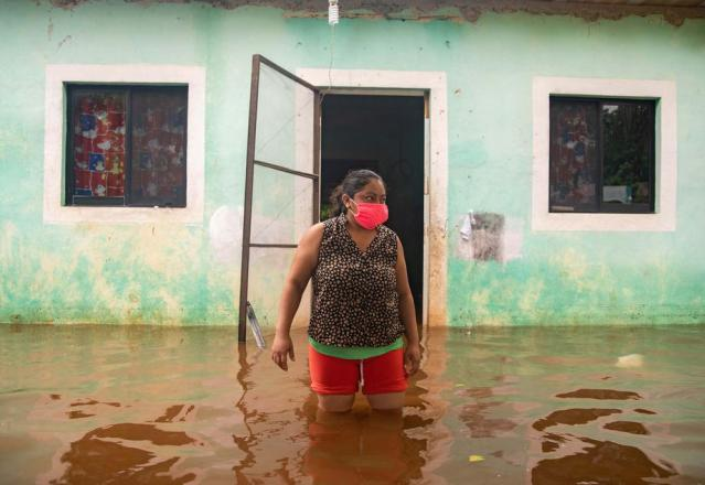 From floods to locusts, 'climate breakdown' cost rich and poor in 2020