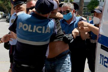 Albanians protest after police shot dead a man for violating coronavirus curfew