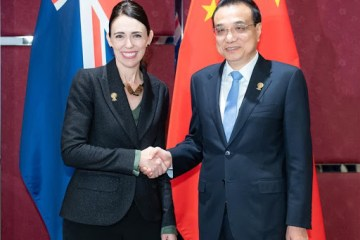 China, NZ ink trade deal as Beijing calls for reduced global barriers