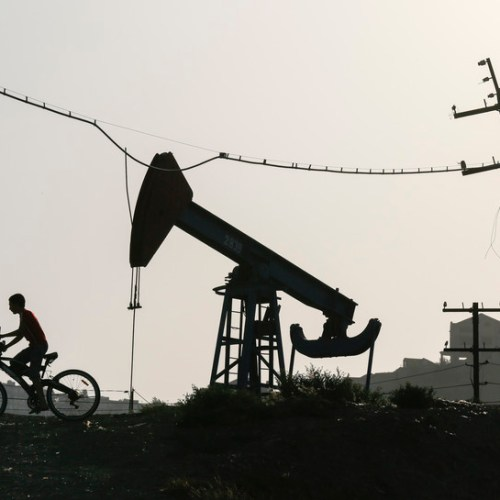 Oil hovers near 11-mth highs, sustained by Saudi output cuts pledge