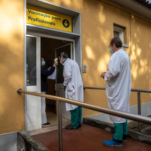 Portugal considers ordering private hospitals to take COVID patients as deaths hit record