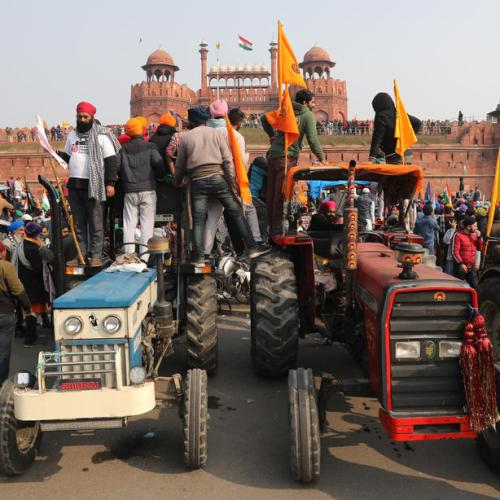 Indian farm protesters battle police to plant flags at historic Red Fort