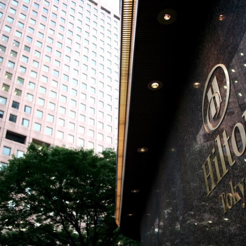 Hilton posts surprise loss as surging COVID-19 cases hurt bookings