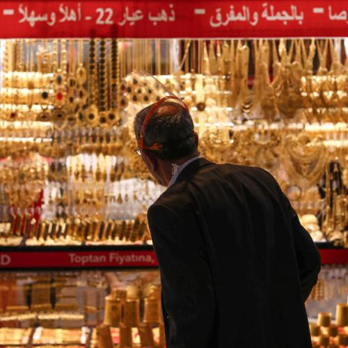 Gold eases on firmer U.S. yields, but set for best week in 7