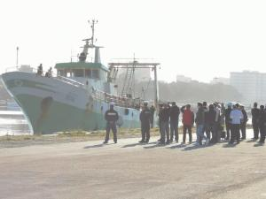 Italian fishing boat involved in Libyan shootout docks in Sicily
