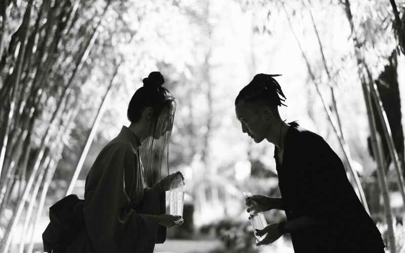 grayscale photo of woman and man