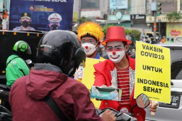 Asian COVID epicentre of Indonesia extends curbs by a week