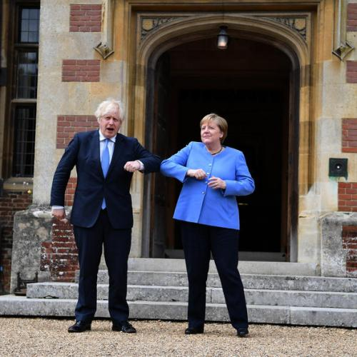 UPDATED: UK PM Johnson meets Germany's Merkel with COVID travel rules in focus