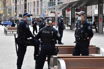 COVID-19 cases surge in Sydney, police cordon off downtown to prevent rally