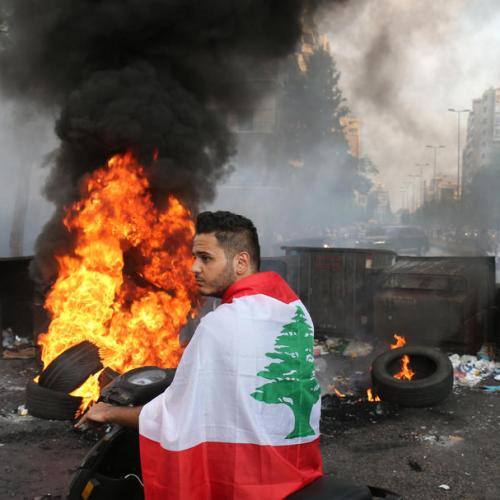 Photo Story – Lebanese people protest after Prime Minister-Designate Saad Hariri stepped down
