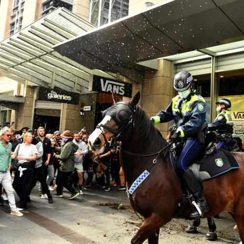 Australians may face longer lockdown after mass protests