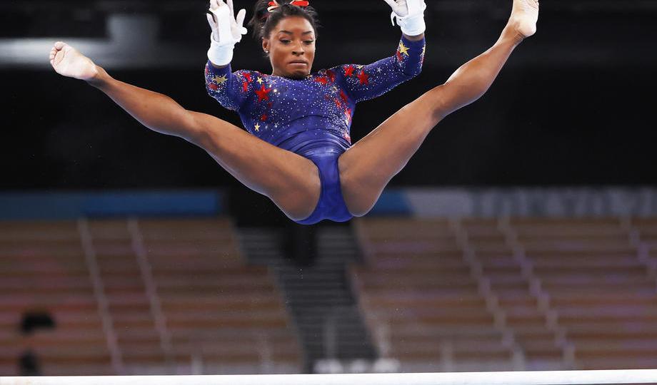 Olympics-Gymnastics: Biles returns to claim balance beam bronze, Guan wins gold