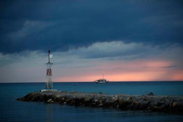 Freighter sinks after hitting Greek islets, all 16 crew rescued
