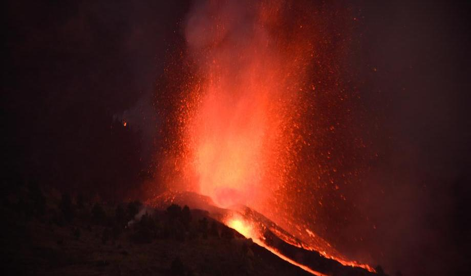 UPDATED: Thousands flee as lava spewing from volcano on Spain's La Palma island destroys houses