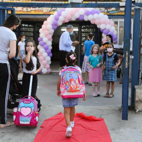 Israeli students return to school amid surge in COVID-19 cases
