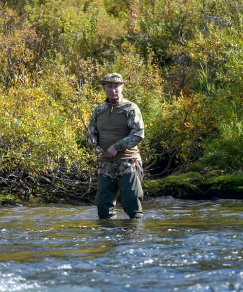 Putin ends self-isolation with Siberian fishing trip