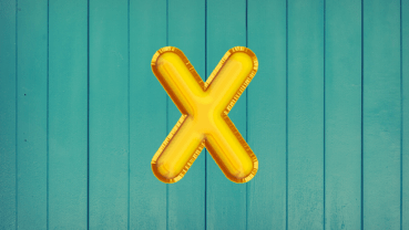 Gold X on a green background
