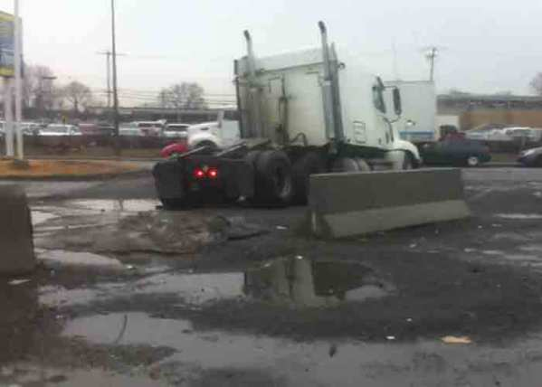 Video: Truck Stuck in Pothole