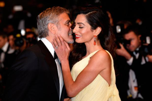 Actor George Clooney and his wife Amal Clooney attend the