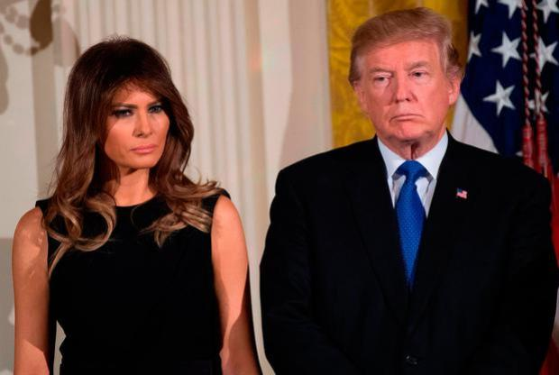 US President Donald Trump and First Lady Melania Trump attend a Hanukkah reception in the East Room of the White House in Washington, DC, December 7, 2017. / AFP PHOTO / SAUL LOEBSAUL LOEB/AFP/Getty Images