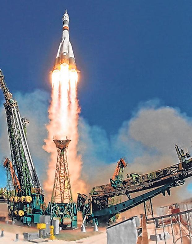 Doomed: The rocket booster with space ship blasts offabout. Photo: AP