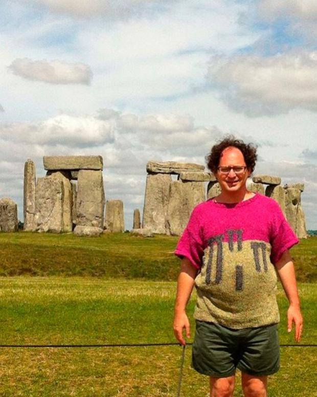 Sam Barsky at Stonehenge wearing a jumper he knitted of the landmark Photo credit: Sam Barsky/PA Wire