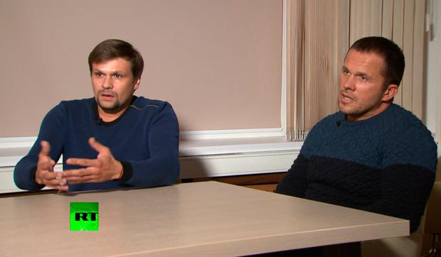 TV denials: Ruslan Boshirov, left, and Alexander Petrov speak with the Kremlin-funded RT channel in Moscow.PHOTO: AP