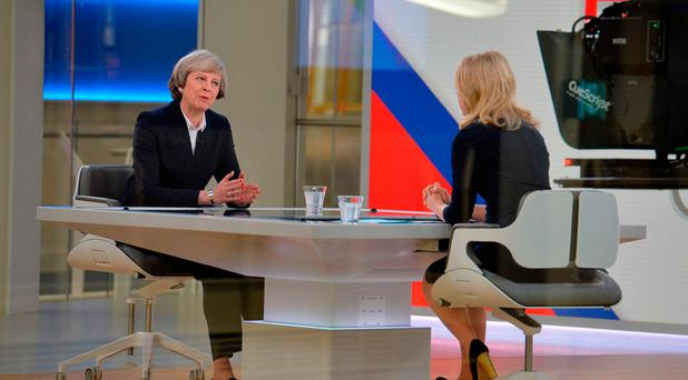 British Prime Minister Theresa May (left) is interviewed by Sophy Ridge on Sky News in London during their Ridge on Sunday programme. Photo: John Stillwell/PA Wire