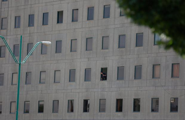 An Iranian policeman looks out of the parliament's building in central Tehran, Iran, June 7, 2017. TIMA via REUTERS