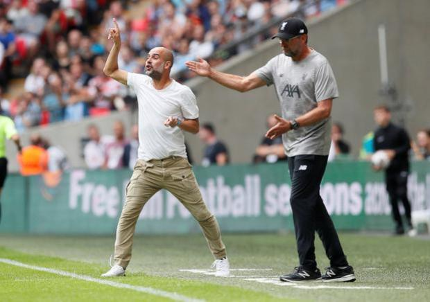 Soccer Football - FA Community Shield - Manchester City v Liverpool - Wembley Stadium, London, Britain - August 4, 2019 Liverpool manager Juergen Klopp and Manchester City manager Pep Guardiola react REUTERS/David Klein