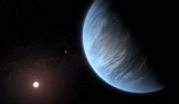 An artist's impression released by Nasa of the planet K2-18b, its host star and an accompanying planet Courtesy ESA/Hubble/M. Kornmesser/NASA