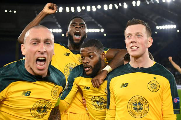 Celtic players celebrate with match-winner Olivier Ntcham after his goal against Lazio in Rome. Photo: REUTERS/Alberto Lingria