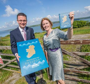 Pictured at the launch of a new passport for the Wild Atlantic Way are Minister of State for Tourism and Sport Patrick O'Donovan with Fiona Monaghan, Head of Wild Atlantic Way, Failte Ireland