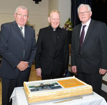 Eugene Caulfield and Seamus Kirk with Fr McGinnity at the retirement function held in his honour. Photo: Ken Finegan
