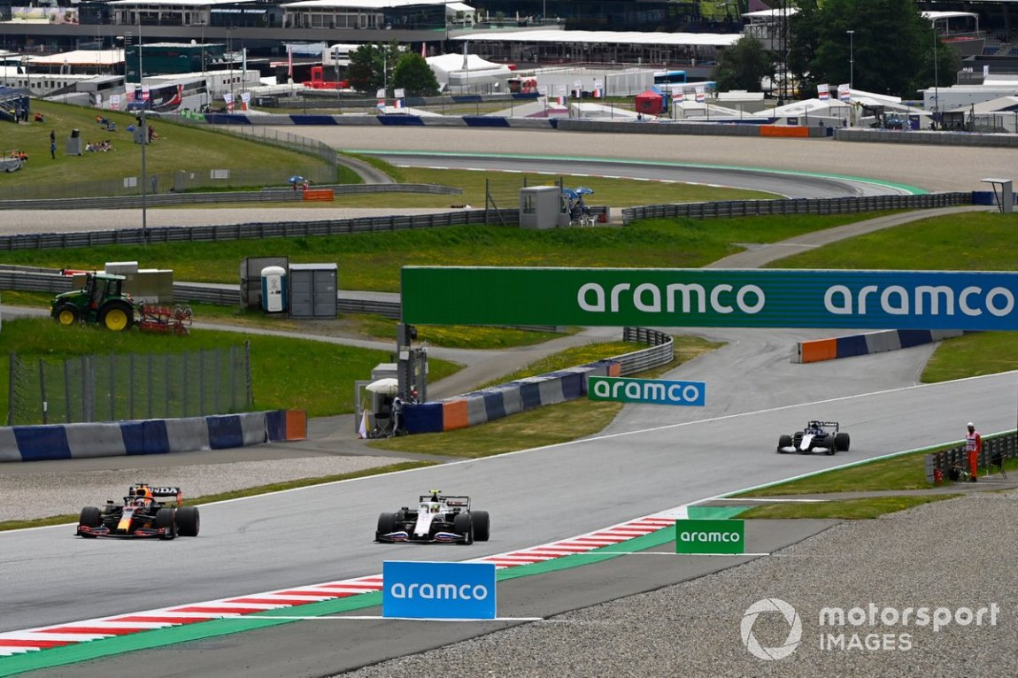 Max Verstappen, Red Bull Racing RB16B, Mick Schumacher, Haas VF-21, and Roy Nissany, test driver, Williams FW43B