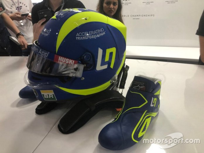 Helmet and boots of Lando Norris, McLaren with the colors of Valentino Rossi