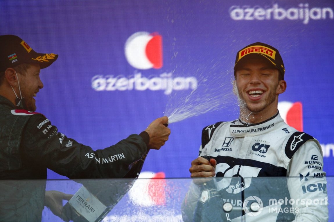 Sebastian Vettel, Aston Martin, 2nd place, sprays Pierre Gasly, AlphaTauri, 3rd place, with Champagne on the podium
