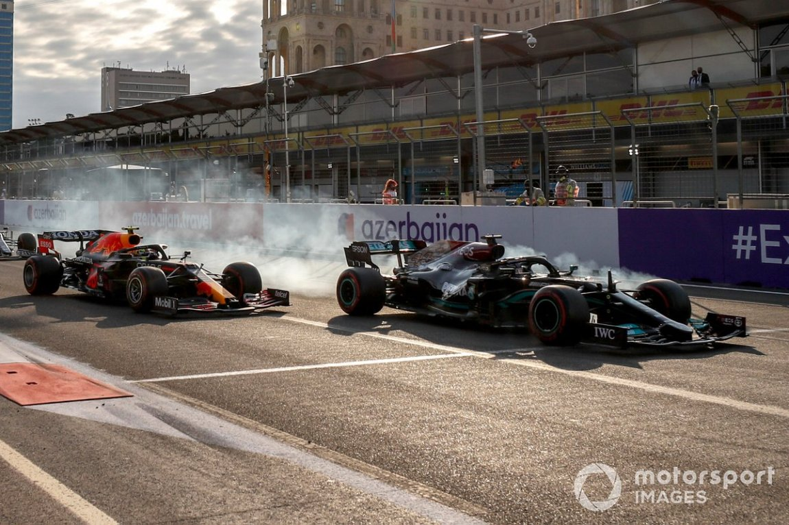 Lewis Hamilton, Mercedes W12 and Sergio Perez, Red Bull Racing RB16B at the restart