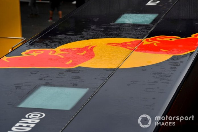 The rain is reflected in a Red Bull logo