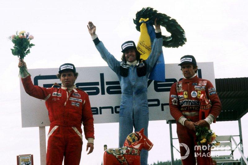 Podium: second place Jochen Mass, McLaren, race winner Jacques Laffite, Ligier, third place Carlos Reutemann, Ferrari