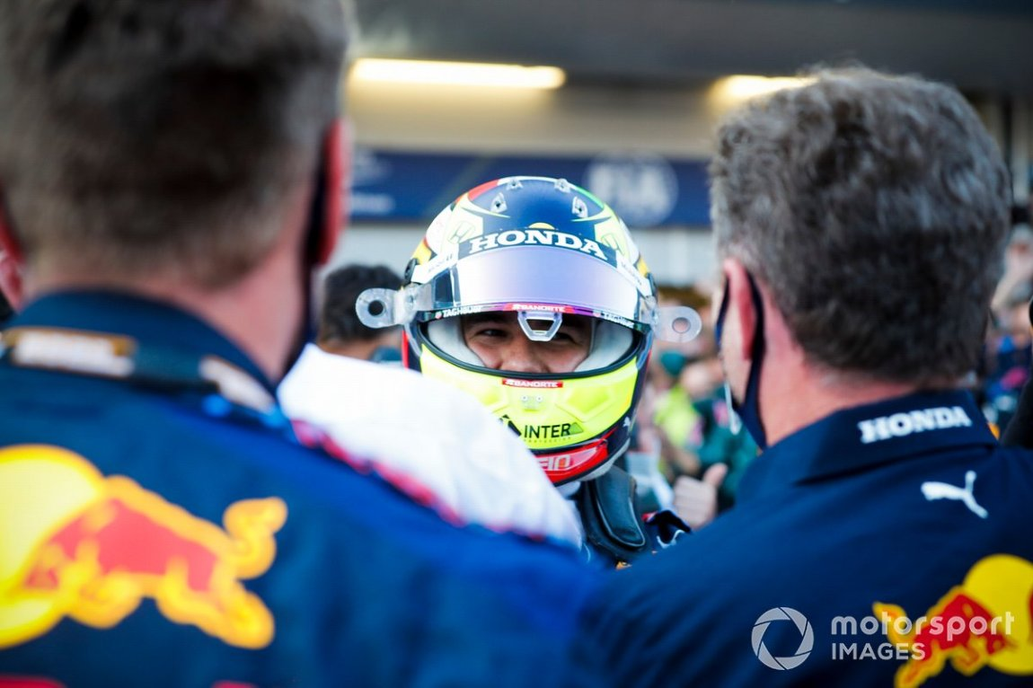 Sergio Perez, Red Bull Racing, 1st classified, celebrates in the Parc Fermé with his team