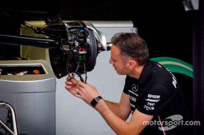 A Mercedes AMG F1 mechanic at work