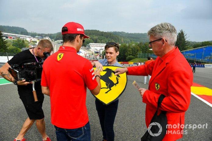 Charles Leclerc, Ferrari, signs autograph for fans