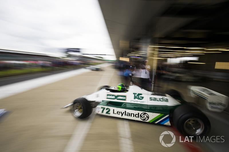 A Williams FW07B Carlos Reutemann leaves the garage