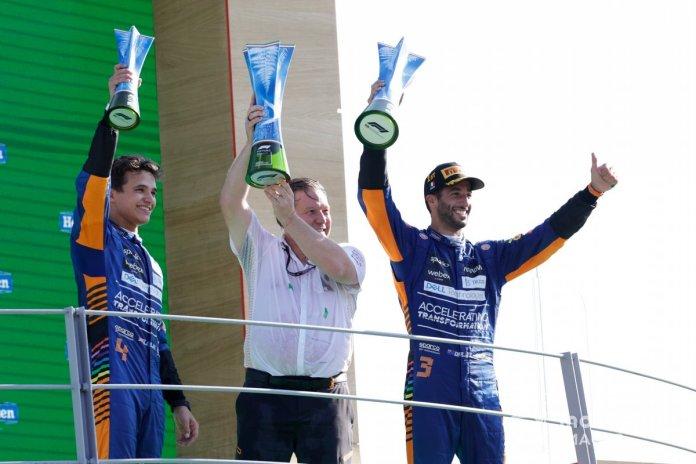 Lando Norris, McLaren, 2nd position, Zak Brown, CEO, McLaren Racing, and Daniel Ricciardo, McLaren, 1st position, with their trophies