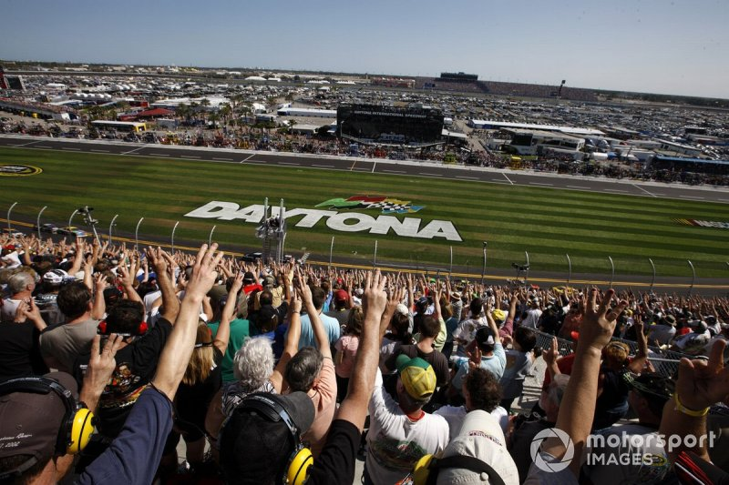 Fans hold up three fingers on the 3rd lap to remember Dale Earnhardt ten years after he died