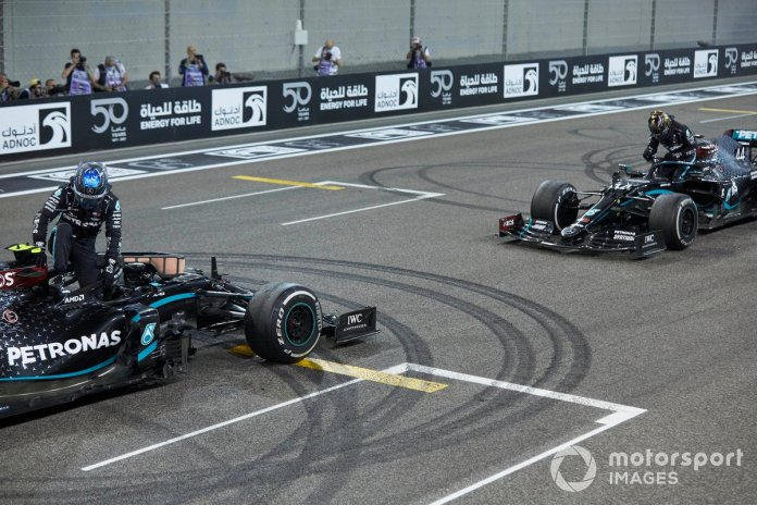 Valtteri Bottas, Mercedes F1 W11, 2nd position, and Lewis Hamilton, Mercedes F1 W11, 3rd position, on the grid after the celebratory donuts